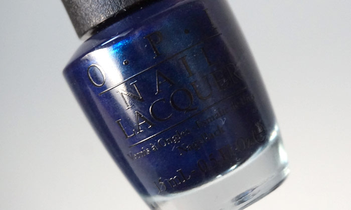 Picture of the bottle of OPI Yoga-ta get this blue, which is a blue shimmery polish