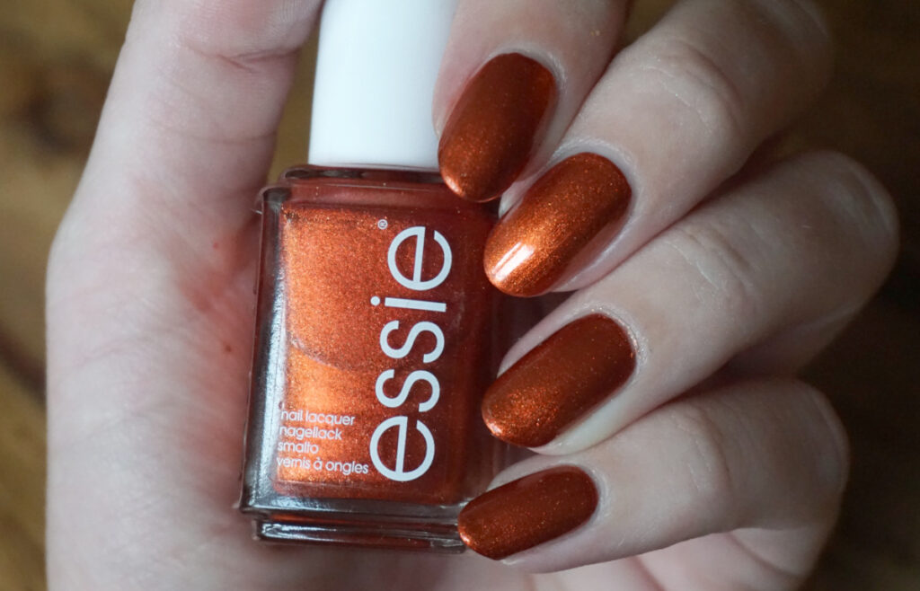 Swatch of Essie say it ain't soho an orange shimmer from Essie's fall 2018 collection